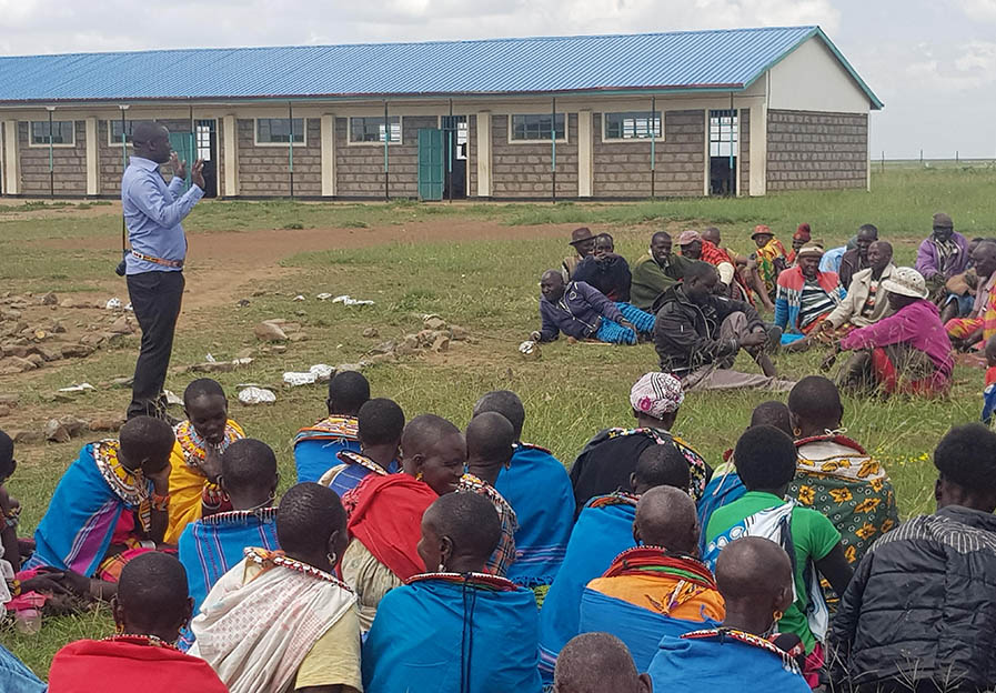 Simon speaking to group in Kenya