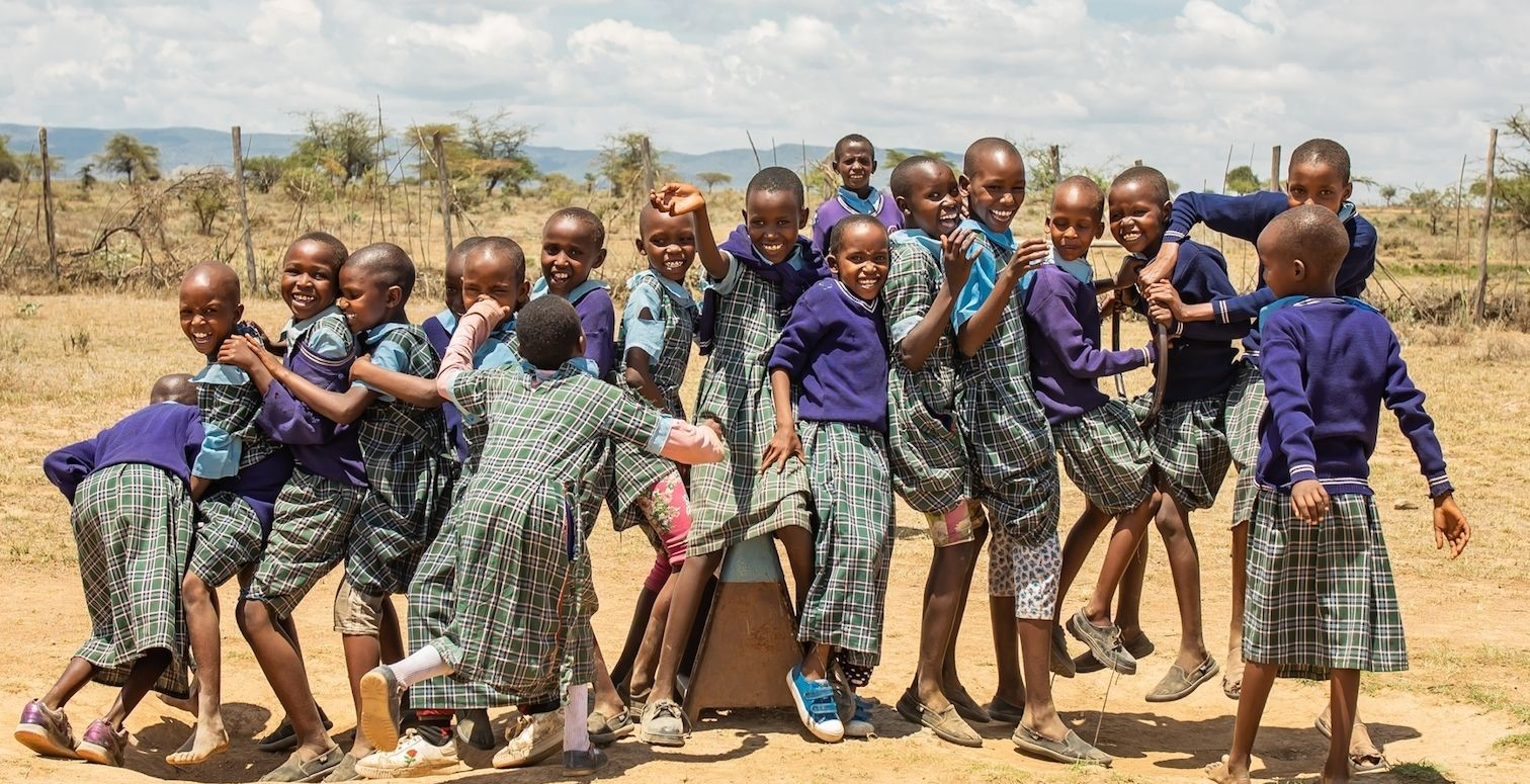 Kenya school kids playing. Sign up for newsletter
