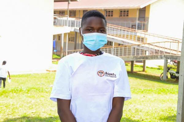 Uganda student wearing mask